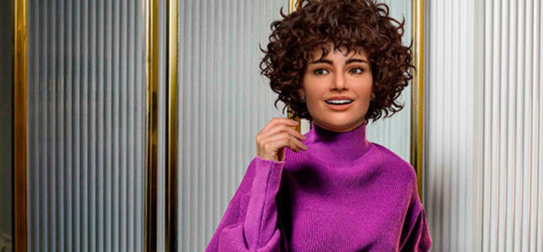 Mara da Amaro posa para uma foto, com blusa lilás e seu novo cabelo cacheado